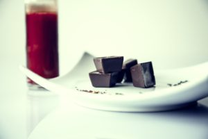 chocolate with red juice in background_ stock photo_COMPRESSED